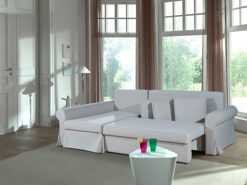 un canapé d'angle convertible en tissu