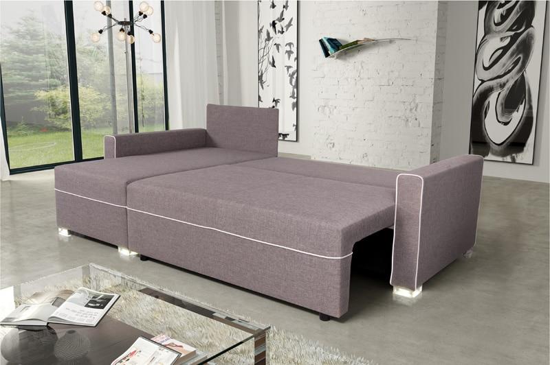 un lit d'appoint avec un canapé convertible